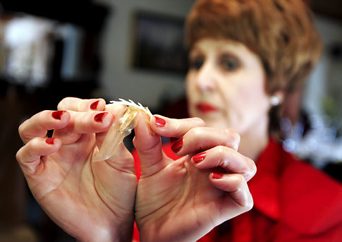image She inserts a tampon with an applicator
