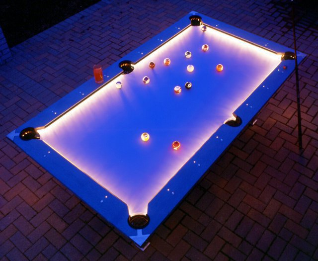 Outdoor Pool Table Features Built-In Lighting For Nighttime Play