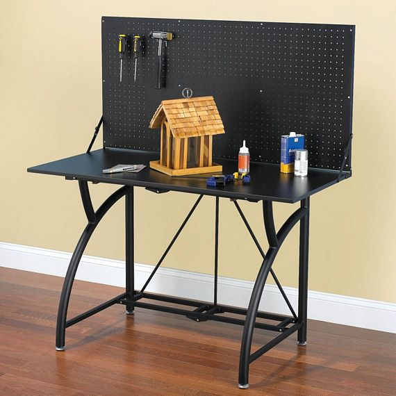 This Compact Folding Workbench Packs Flat For Storage