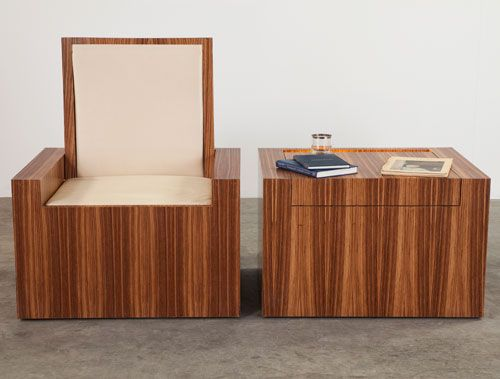 little oyster is a coffee table that's also a chair that's also a