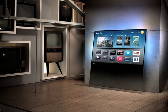 Philips DesignLine TV Ditches The Bezel - Black wall behind tv