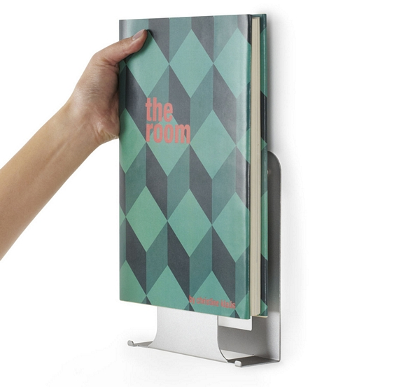 each umbra conceal vertical display which measures 575 x 7 x 15 inches can hold just one book giving the hardback prominent placement while keeping