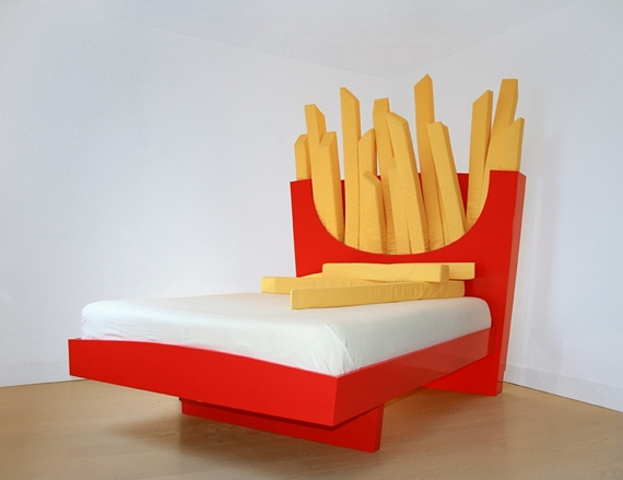 those french fries on the headboard are actually bolster cushions that you can use as body pillows while you curl up on the bed