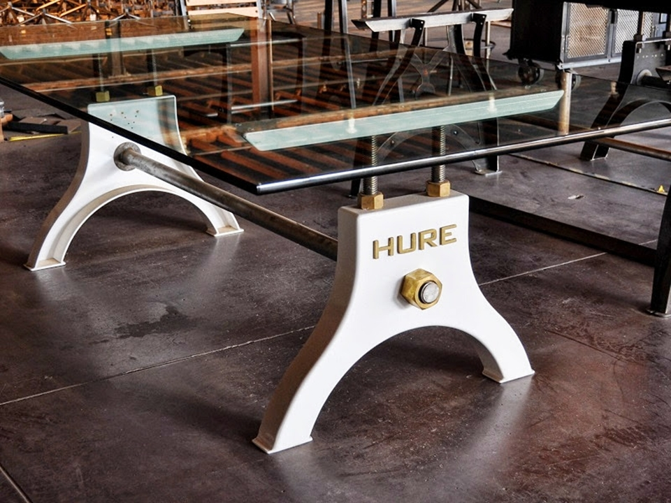 hure crank table brings industrial elegance to the dining room