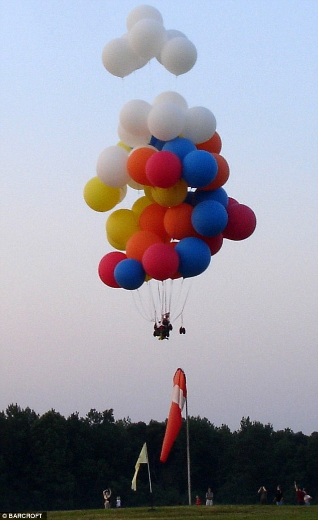 Man Flies In An Office Chair Strapped To 55 Balloons